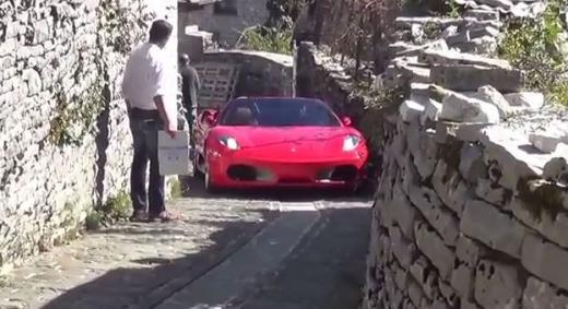 Ferrari F430 Spider trying to navigate through narrow streets in Greece