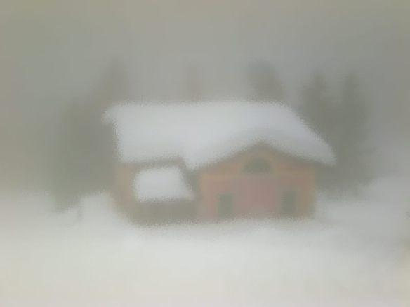 snowy house in fog